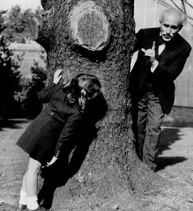 Arturo Toscanini playing hide and seek with his granddaughter, 1938.